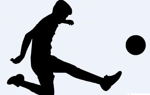 Silhouette of Person Kicking Ball